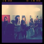 watching the Soapbox Melodics performance at Photo Graphic Exhibit