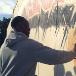 Vernon Davis autographing our mural