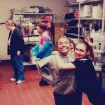 Jasi's softball team cleaning for Pizza Night